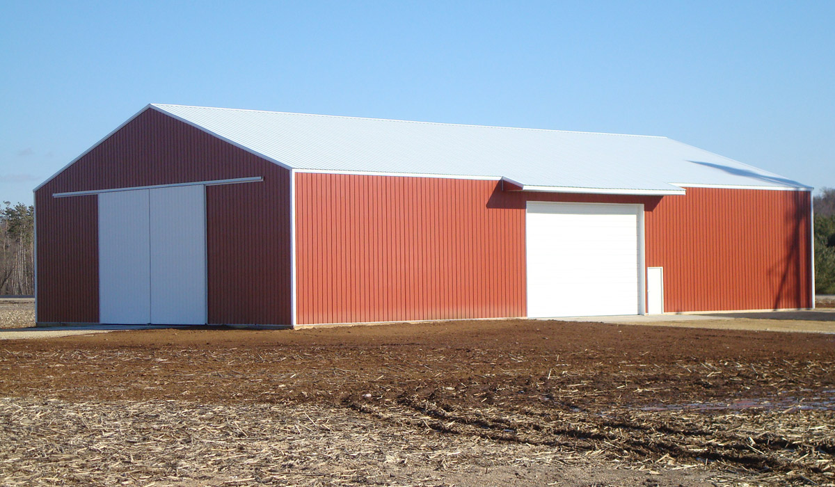 Pole building for agricultural machinery built by Simmons Construction - General Contractor